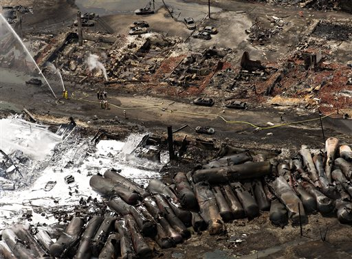 The downtown core lays in ruins as fire fighters continue to water smoldering rubble Sunday in Lac-Mégantic, Quebec. Franklin County Emergency Management Director Tim Hardy and Phillips firefighter Josh Bachelder called the Saturday train derailment and fire in Lac-Mégantic, Quebec, a horrific scene of destruction.