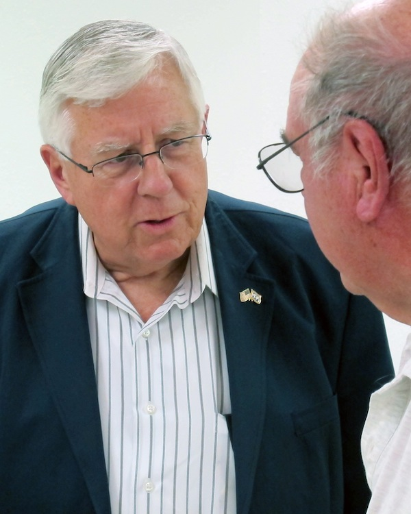 This July 2, 2013 photo shows U.S. Sen. Mike Enzi, R-Wyo., talks to constituent John Marquardt at a senior center in Pine Bluffs, Wyo. Enzi, on the left, hasn't said yet whether he will seek re-election to the Senate while Liz Cheney, daughter of former Vice President Dick Cheney, has said she's prepared to challenge him in the 2014 Republican primary. (AP Photo/Ben Neary)