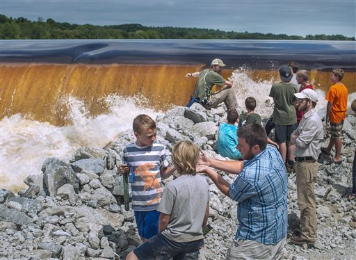 Hundreds of people came to watch the ceremonial breaching of the Veazie Dam in Eddington Monday. Spectators were able to walk alongside the riverbank below the dam. Restoring Atlantic Salmon to the Penobscot River by the breaching of the Veazie Dam has been the collaborative effort of the Penobscot Indian Nation, seven conservation groups and state and federal agencies.