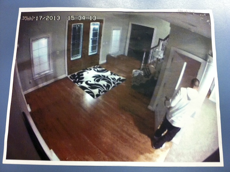 This photo taken from former New England Patriots player Aaron Hernandez's home surveillance system in North Attleborough, Mass., and released in documents by Attleboro District Court on July 9, 2013, as one in a series of images authorities said show Hernandez at home with what appears to be a gun, shortly after Odin Lloyd was shot to death on June 17. Hernandez pleaded not guilty to murder in Lloyd's death. (AP Photo/Attleboro District Court)