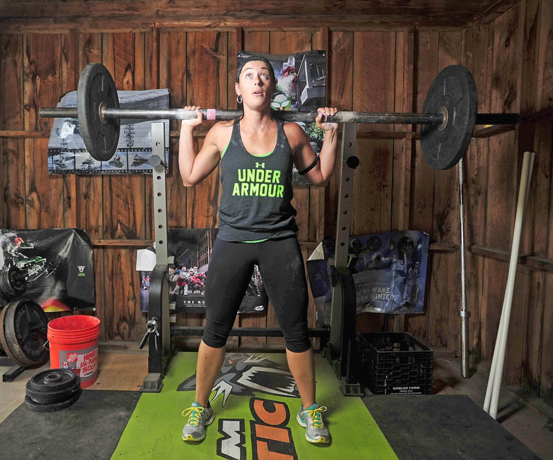 "WORKING HARD: Holly MacKenzie, winner of the Under Armor ""What's Beautiful"" contest, works out in her gym in the garage at her Oakland residence on Tuesday."