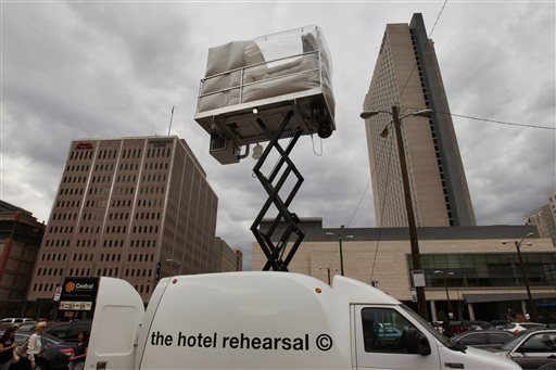A hotel room made of aluminum and inflated vinyl is held aloft by a van-mounted scissor lift, on promotional display in a parking lot in downtown Denver on July 25, 2013.