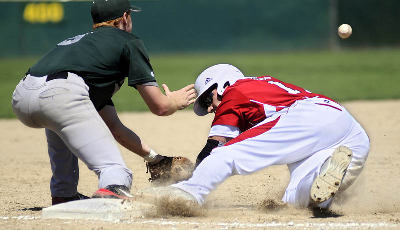SAFE AT THIRD: The Red Barn's Jory Humphrey slides under a throw to Pastime's Ryan Riordan at third base during the American Legion state tournament Wednesday in Augusta.