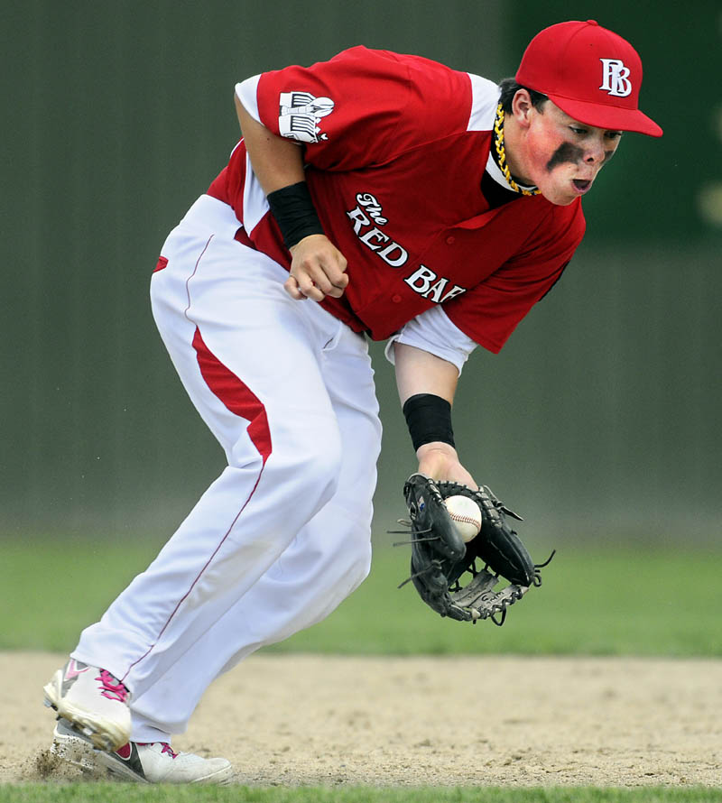 EYE ON THE BALL: The Red Barn's Tucker Whitman watches the ball into his glove in a game against Pastime during the American Legion state tournament Wednesday in Augusta.