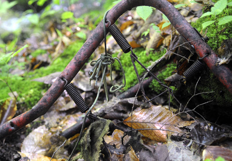 A metal bed frame in a collapsed shelter in Rome that Garrett Hollands discovered in the late 1980s and believed was inhabited by Christopher Knight, a.k.a the North Pond Hermit.