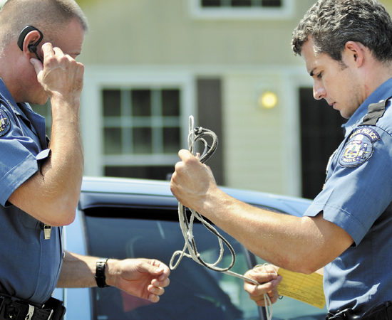 State Troopers Greg Stevens, left, and Jon Leach collect a length of rope Wednesday that was allegedly used to restrain a man who was held hostage overnight in Chelsea house. State Police arrested two men Wednesday morning following a brief foot chase on kidnapping charges after the victim fled the Hankerson Road home, according to police. The male victim, who police declined to identify, was described as being in good condition. Maine Drug Enforcement Agents and Kennebec County Deputies assisted the State Police in a search of the residence after obtaining a warrant Wednesday afternoon.