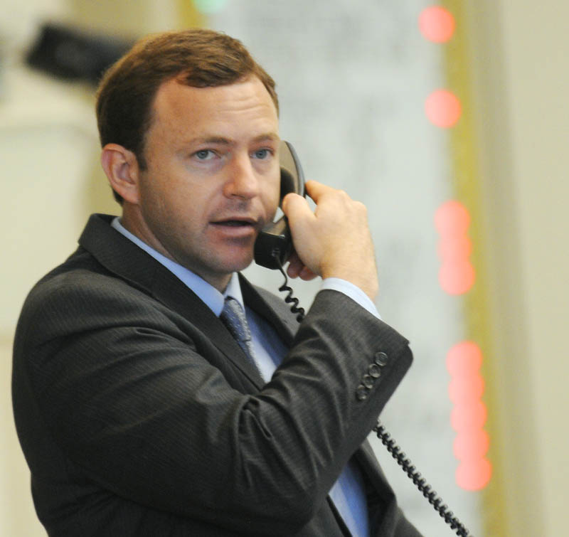 Speaker of the House Mark Eves, D-North Berwick, speaks on the phone during a vote Tuesday in the House of Representatives.