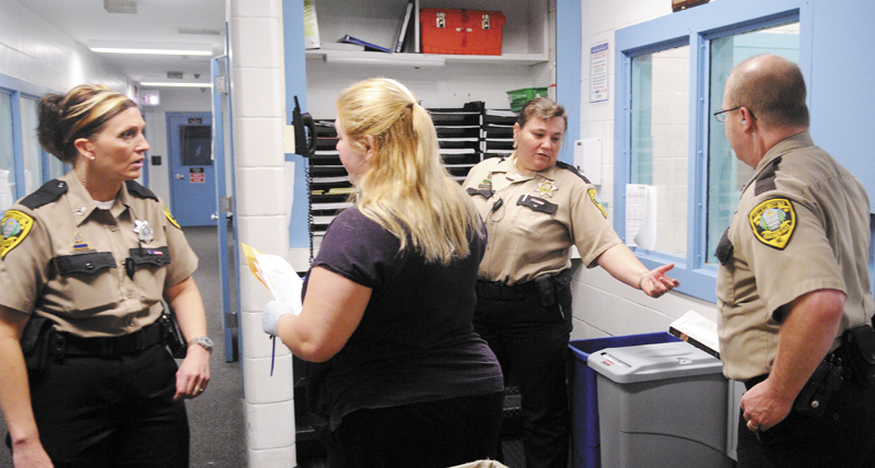 Kennebec County Corrections Facility officers and staff check a cell block May 30 at the jail in Augusta.