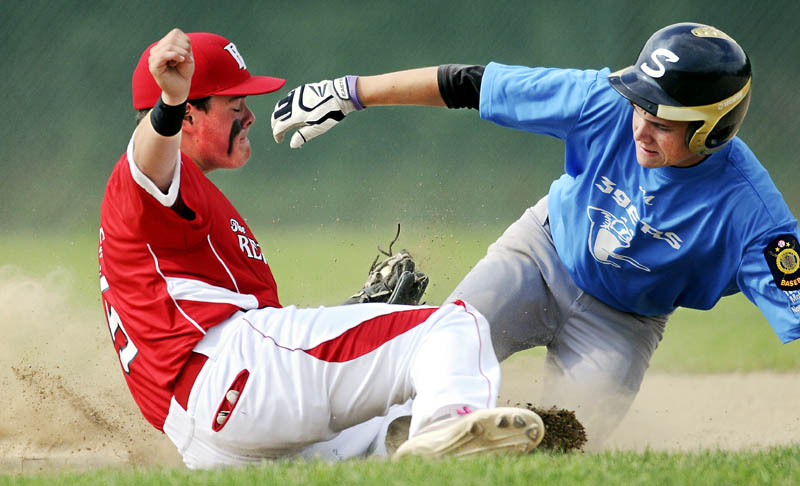 TAG HIM: Augusta Post 205's Tucker Whitman applies a tag to Madison Post 39's Trey Michonkski on Monday at second base during an American Legion tournament match up in Augusta.