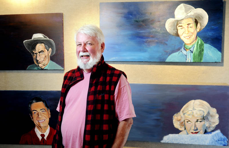 "University of Maine at Augusta professor J. Powers ""Kid"" McGuire stands near some work in his show at the Danforth Gallery on Wednesday. The four paintings, titled ""Rogers-o-rama,"" depict Roy Rogers, top right, Ginger Rogers, Will Rogers, top left, and Fred Rogers."