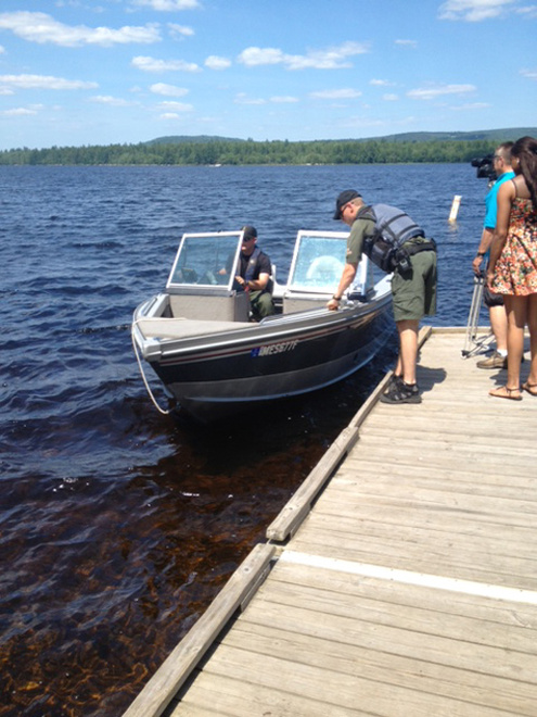 Wardens and divers search Great Moose Lake in Hartland for missing fisherman William Witt, 66, of Harmony.