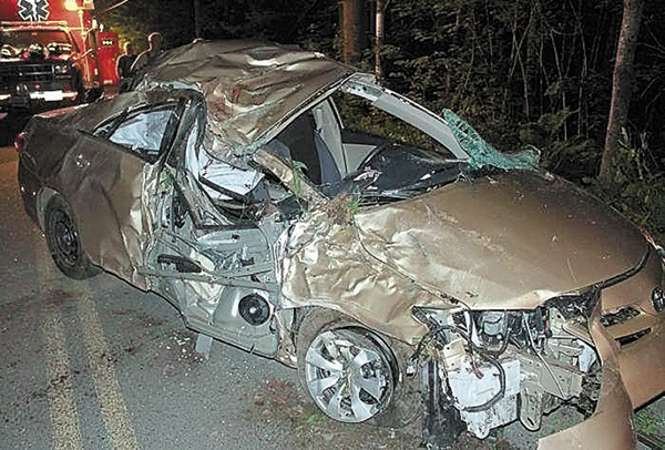 A 2011 Toyota Corolla is seen after crashing into a tree June 16, 2012 in Belgrade. The driver, Travis Lawler, 22, originally from the Oakland area was ordered to serve an initial four years behind bars for a drunken-driving crash that killed his sister and her boyfriend in Belgrade.