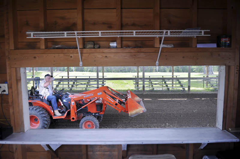 Duddy Brown grades the soil in the Greg Baker Pulling Ring at the Pittston faiground on Sunday. Several volunteers are preparing the fairground for the annual agricultural exhibition, which is scheduled to commence Thursday and wrap up Sunday.
