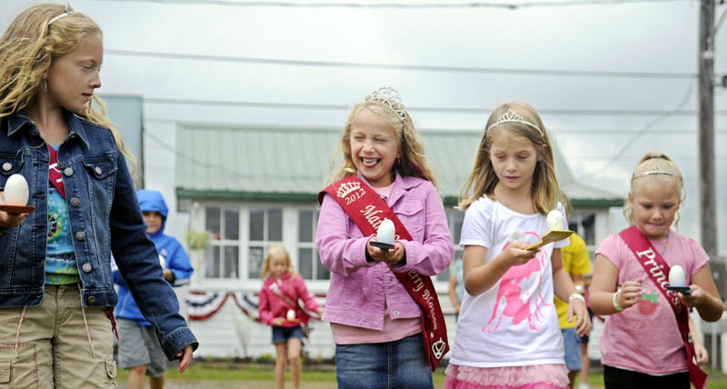 Children compete in the egg and spoon contest today, on the fourth and final day of the Pittston Fair. Volunteers, sponsors and vendors reported good attendance this year for the annual agricultural event.