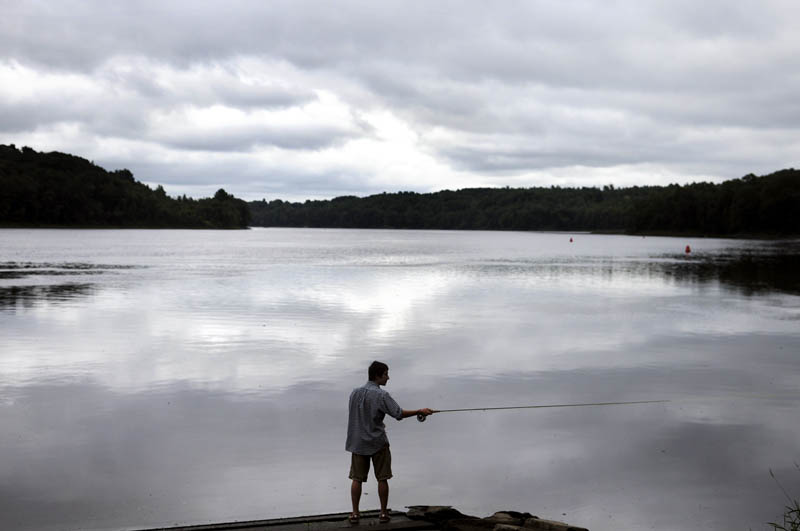 Mathias Deming, of Winthrop, casts today on the Kennebec River in Hallowell while fishing a buddy. The anglers reported catching a few bass while fly fishing together.