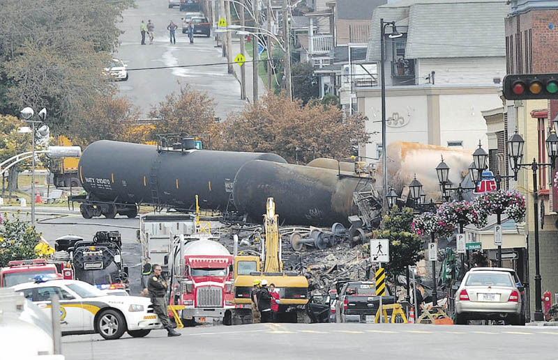 Crude oil tankers from the Montreal, Maine & Atlantic railways are seen in the heart of downtown Lac-Megantic, Quebec, where the runaway train exploded killing at least 20 with 40 others still missing and presumed dead.