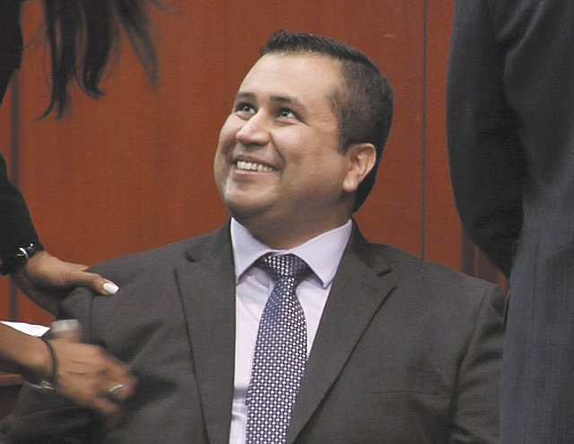 George Zimmerman smiles after a not guilty verdict was handed down in his trial at the Seminole County Courthouse in Sanford, Fla. Neighborhood watch captain George Zimmerman was cleared of all charges Saturday in the shooting of Trayvon Martin, the unarmed black teenager whose killing unleashed furious debate across the U.S. over racial profiling, self-defense and equal justice.