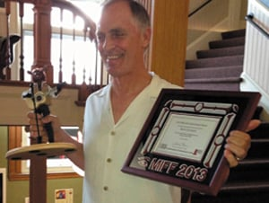 Keith Carradine accepts his Mid-Life Achievement Award Monday at the Maine International Film Festival.
