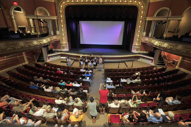 James Coleman hands out awards to student directors during the Maine Student Film Festival at the Waterville Opera House on Saturday.