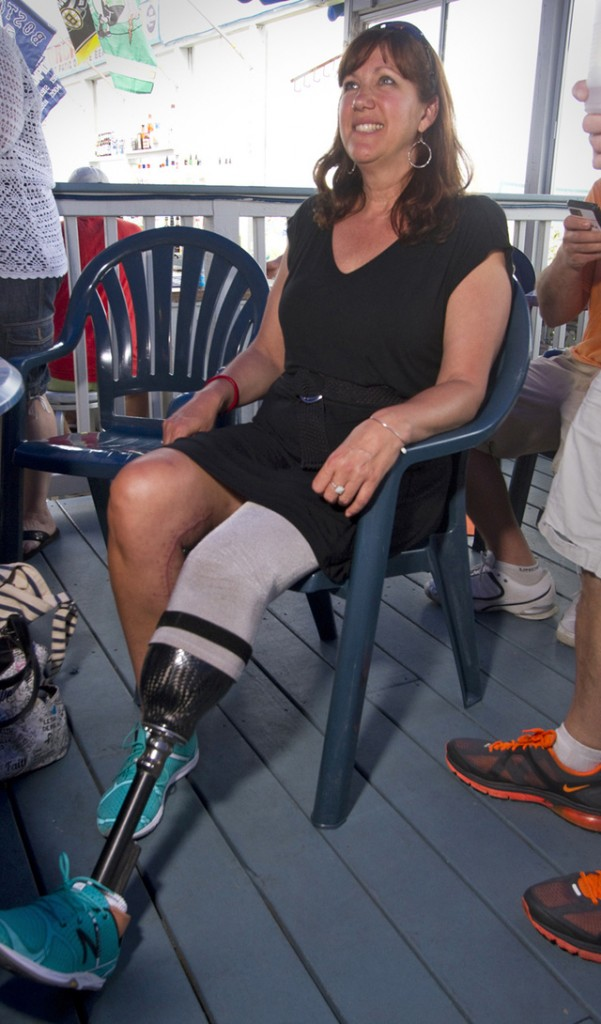 Boston Marathon bombing victim Karen Rand meets supporters in Old Orchard Beach for a fundraiser to help build a handicapped accessible home for Rand. Rand graduated from Westbrook High School and will be the ceremonial starter for this year's Beach to Beacon 10K race.