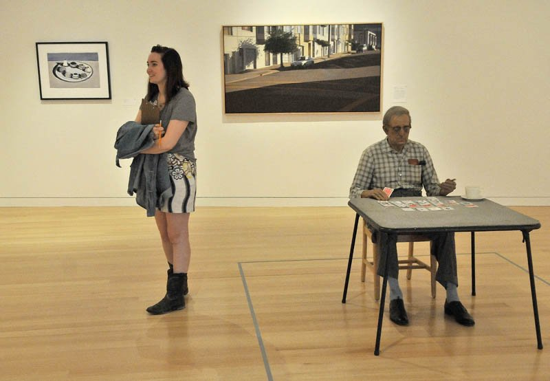 "Blair Hudson, 18, a student at the Maine Academy of Natural Sciences, stands next to a Duane Hanson's ""Old Man Playing Solitaie, 1973,"" during a private tour of the Colby College Museum of Art, before the Community Day Celebration scheduled for Sunday."