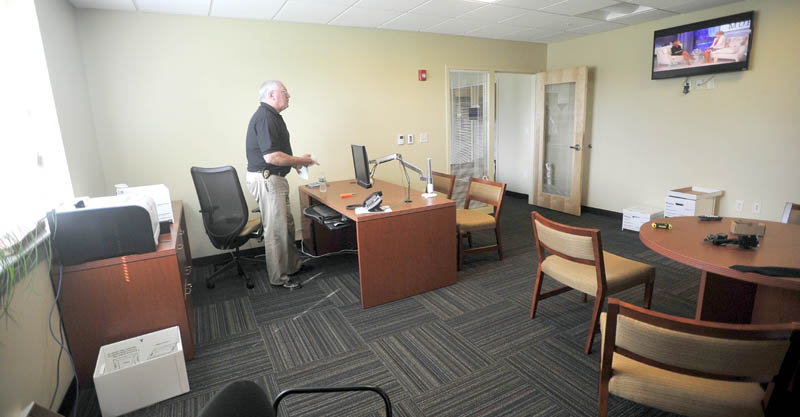 Waterville Police chief, Joseph Massey, settles in to his office at the new police station on Colby Circle on Thursday.
