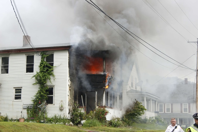 Fire ravages through apartments at 62 Washington St. in Augusta Thursday evening.