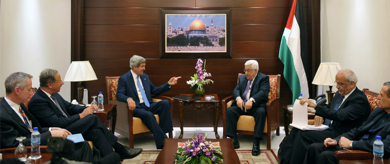 U.S. Secretary of State John Kerry, center left, meets with Palestinian President Mahmoud Abbas, center right, on Friday, in the West Bank city of Ramallah.