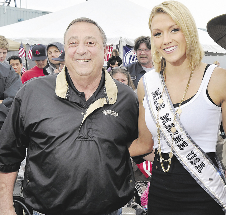 This file photo shows Gov. Paul LePage and then Miss Maine USA Ashley Marble at the 2011 Lobster Festival on Maine State Pier.
