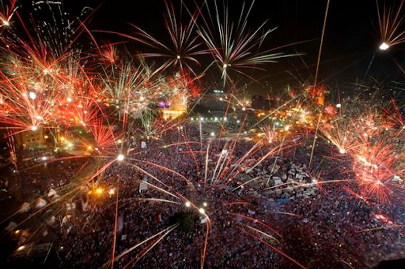 "Fireworks light the sky opponents of Egypt's Islamist President Mohammed Morsi celebrate in Tahrir Square in Cairo, Egypt, Wednesday, July 3, 2013. A statement on the Egyptian president's office's Twitter account has quoted Mohammed Morsi as calling military measures ""a full coup."" The denouncement was posted shortly after the Egyptian military announced it was ousting Morsi, who was Egypt's first freely elected leader but drew ire with his Islamist leanings. The military says it has replaced him with the chief justice of the Supreme constitutional Court, called for early presidential election and suspended the Islamist-backed constitution. (AP Photo/Amr Nabil)"
