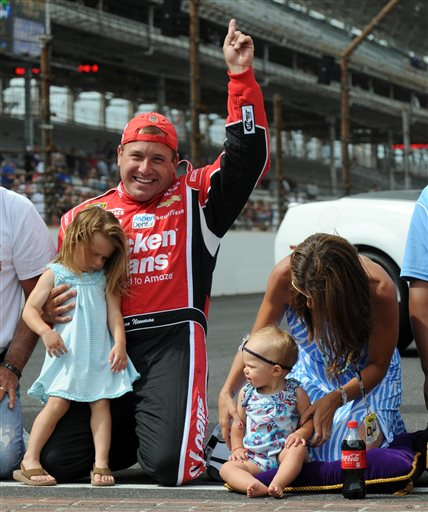 Ryan Newman, second from left, celebrates with his wife, Krissie, and daughters, Brooklyn, left, and Ashlyn, after winning the Brickyard 400 Sunday at the Indianapolis Motor Speedway.