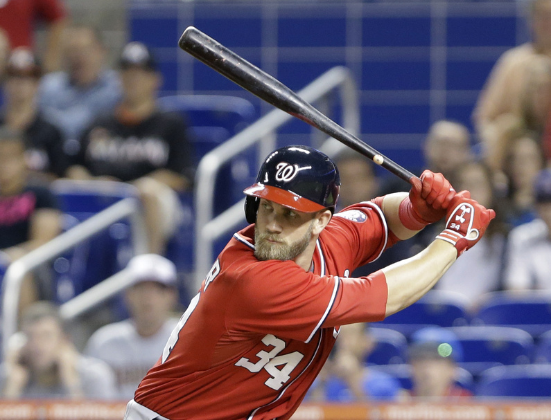 Washington Nationals' Bryce Harper bats during the first inning of a baseball game against the Miami Marlins on Saturday in Miami. He's one of a group of young, talented players who've brought new energy to the game.