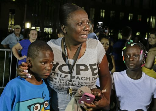 Darrsie Jackson, center, reacts after hearing the verdict of not guilty in the trial of George Zimmerman with her children, Linzey Stafford, left, 10, and Shauntina Stafford, 11, at the Seminole County Courthouse in Sanford, Fla., tonight.