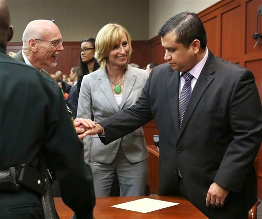 George Zimmerman, right, is congratulated by his defense team after being found not guilty during Zimmerman's trial in Seminole circuit court in Sanford, Fla. tonight. Jurors found Zimmerman not guilty of second-degree murder in the fatal shooting of 17-year-old Martin in Sanford, Fla. The six-member, all-woman jury deliberated for more than 15 hours over two days before reaching their decision.