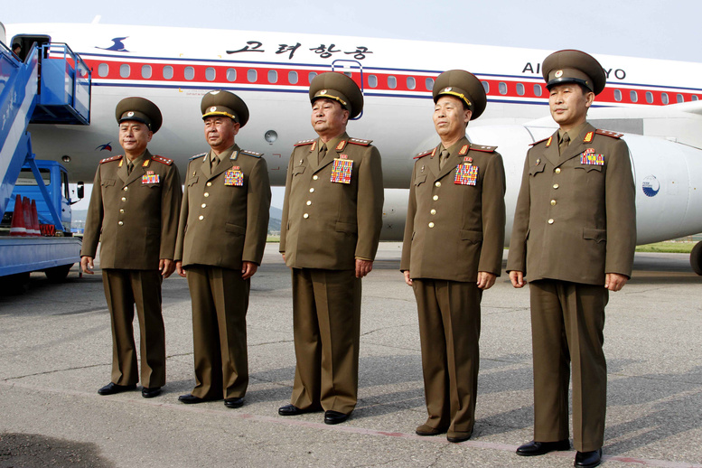 North Korea's military delegation members led by chief of the General Staff of the people's army, Kim Kyok Sik, center, pose for photos before leaving for Cuba at the Pyongyang Airport on June 26. A North Korean ship carrying weapons system parts buried under sacks of sugar was seized as it tried to cross the Panama Canal on its way from Cuba to its home country, which is under a United Nations arms embargo, Panamanian officials said Tuesday.