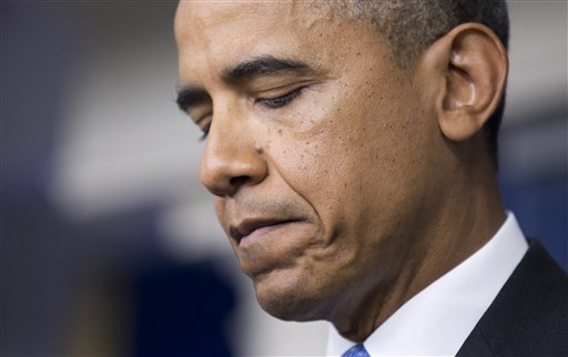"""Speaking in a surprise appearance Friday at the White House, President Barack Obama said black Americans feel pain after the Trayvon Martin verdict because of a """"history that doesn't go away."""""""