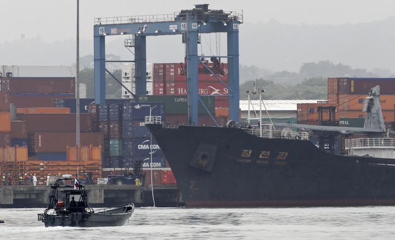 Police patrol by boat next to the North Korean-flagged cargo ship Chong Chon Gang docked at the Manzanillo International container terminal on the coast of Colon City, Panama, Tuesday, July 16, 2013. Panama's president said the country has seized the ship, carrying what appeared to be ballistic missiles and other arms that had set sail from Cuba. (AP Photo/Arnulfo Franco)