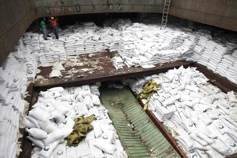 Panamanian workers stand atop sacks of sugar inside a container of a North Korean-flagged ship at the Manzanillo International container terminal on the coast of Colon City, Panama, on Tuesday.