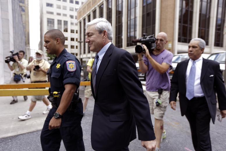 Former Penn State president Graham Spanier walks to the Dauphin County Courthouse on Monday in Harrisburg, Pa. Spanier faces charges in the child sex abuse scandal involving former assistant football coach Jerry Sandusky.