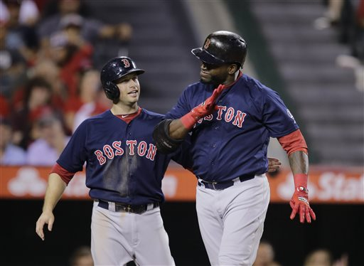 Boston Red Sox's David Ortiz, right, celebrates his two-run home run with Daniel Nava during the eighth inning of a baseball game against the Los Angeles Angels in Anaheim, Calif., Friday, July 5, 2013. (AP Photo/Jae C. Hong)