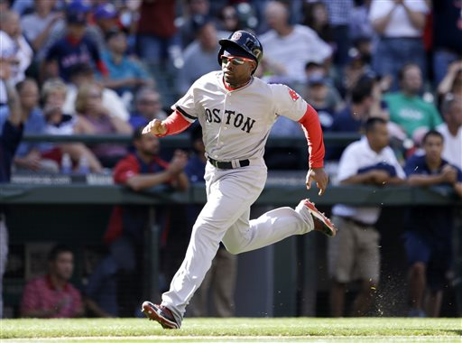 Boston Red Sox's Jackie Bradley Jr. comes around to score against the Seattle Mariners in the 10th inning of the Red Sox' 8-7 win on Thursday in Seattle.