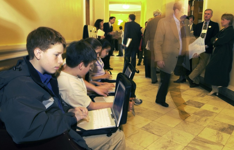 "In this 2002 file photo, Shapleigh Middle School seventh-graders use their laptops in the hallway outside the Senate chamber as lawmakers and lobbyists go about business at the Maine State House in Augusta. Maine's ""F"" grade for government integrity, issued last year by a national group, has led to reforms in the state's ethics rules, including a bipartisan transparency bill proposed by Gov. Paul LePage that he signed into law last week. (AP Photo/Pat Wellenbach) Computers"