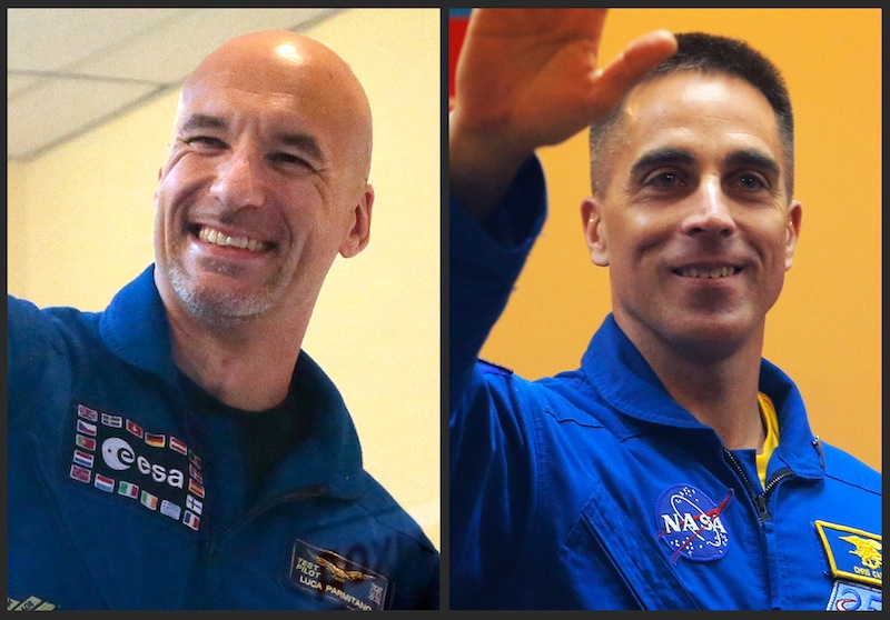This combination of 2013 file photos shows European Space Agency astronaut Luca Parmitano of Italy, left, and U.S. astronaut Christopher Cassidy in the Baikonur cosmodrome in Kazakhstan. In one of the most harrowing spacewalks in decades, Parmitano had to rush back into the International Space Station on Tuesday, July 16, 2013 after a mysterious water leak inside his helmet robbed him of the ability to speak or hear and could have caused him to choke or even drown. His spacewalking partner, Cassidy, had to help him inside after NASA quickly aborted the spacewalk. (AP Photo/Mikhail Metzel, Dmitry Lovetsky)