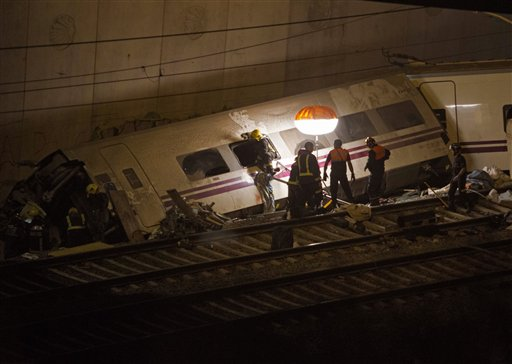 Emergency personnel conduct rescue operations Thursday at the site of a train derailment in Santiago de Compostela, Spain. The passenger train derailed Wednesday night on a curvy stretch of track in northwestern Spain, the country's worst rail accident in decades.