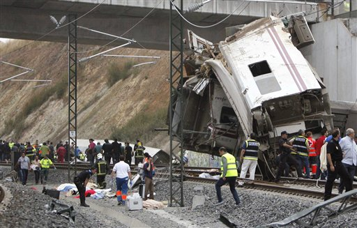 Emergency personnel respond to the scene of a train derailment in Santiago de Compostela, Spain, on Wednesday. Although it was not one of Spain's fastest trains, it was a relatively luxurious version that uses the same kind of track as Spain's fastest expresses.