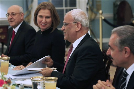 Israel's Justice Minister and chief negotiator Tzipi Livni, second left, Palestinian chief negotiator Saeb Erekat, second right, Yitzhak Molcho, an adviser to Israeli Prime Minister Benjamin Netanyahu, left, and Mohammed Shtayyeh, aide to Palestinian President Mahmoud Abbas, right, are seated across from Secretary of State John Kerry, not pictured, at an Iftar dinner, which celebrates Ramadan, at the State Department in Washington, marking the resumption of Israeli-Palestinian peace talks on Monday.