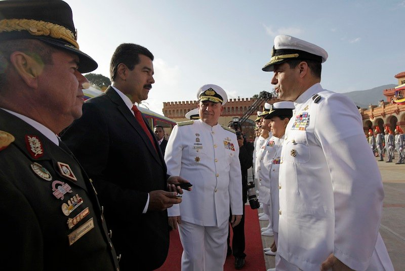 Venezuela's Defense Minister Admiral Diego Molero, far left, Venezuela's President Nicolas Maduro, second from left, and Chief of Strategic Command Gen. Wilmer Barrientos, center, attend a military promotion ceremony at the 4F military museum in Caracas, Venezuela, Friday, July 5, 2013. On Friday Venezuela marks its 202 independence anniversary from Spain. (AP Photo/Ariana Cubillos)