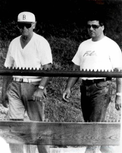 """This undated surveillance photo released Monday by the U.S. Attorney's Office at federal court in Boston shows James """"Whitey"""" Bulger, left, walking with his former right hand man, Kevin Weeks. Weeks took the witness stand Monday at Bulger's racketeering trial and described a double slaying, multiple extortions and drug dealing."""