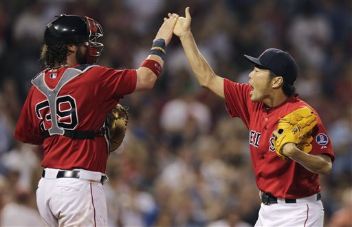 Boston Red Sox relief pitcher Koji Uehara, right, leaps high fives catcher Jarrod Saltalamacchia after getting New York Yankees' Eduardo Nunez to ground out to end the game during the ninth inning of a baseball game at Fenway Park, Friday, July 19, 2013, in Boston. (AP Photo/Charles Krupa)