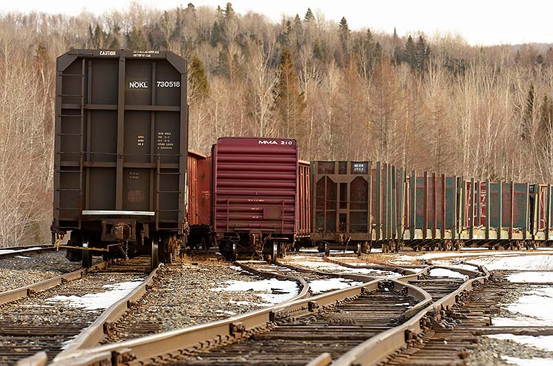 In this Feb. 19, 2010 file photo, rail cars sit idled on the Montreal, Maine & Atlantic Railway junction in Oakfield, Maine.